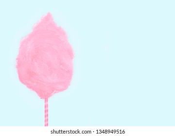 Sweet pink cotton candy isolated on soft mint green background.