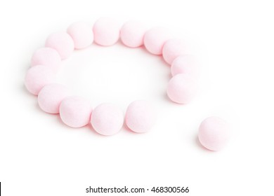 Sweet pink necklace, Strawberry bonbons, Candy white background, Children pink necklace