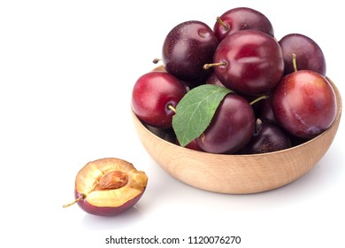 Sweet plums in bowl isolated on white background