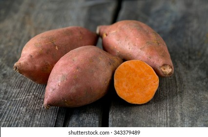 sweet poato on wooden surface