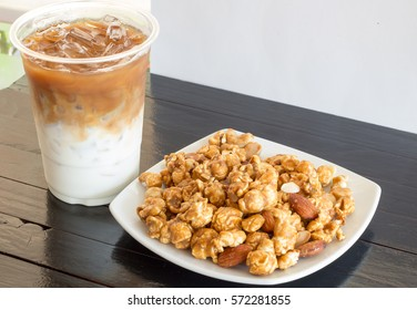 The sweet popcorn with almond served with ice coffee with milk