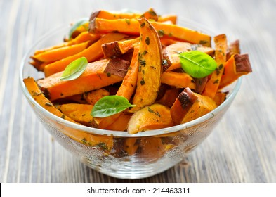 Sweet potato in a bowl on wooden background