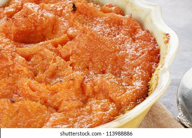 Sweet potato casserole. Extreme shallow depth of field with selective focus on center on potatoes.