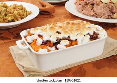 Sweet potato casserole topped with cranberries, candied walnuts and marshmallows