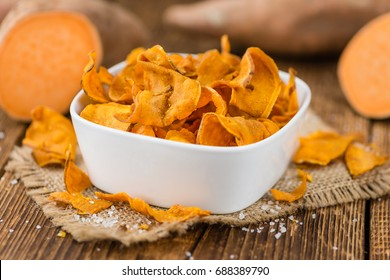 Sweet Potato Chips on a vintage background as detailed close-up shot, selective focus