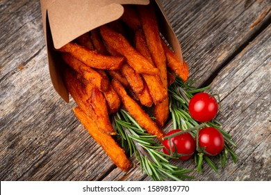 Sweet potato chips/fries on the wooden table