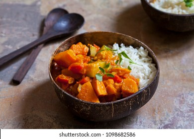 Sweet potato, courgette and red pepper vegan curry with rice and micro coriander