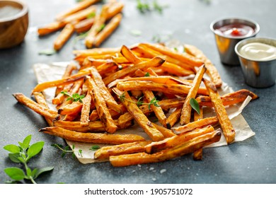 Sweet potato fries with mayo and ketchup, homemade roasted in the oven - Shutterstock ID 1905751072