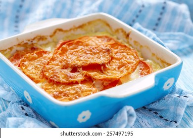 Sweet potato gratin with cream in baking dish