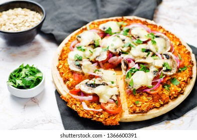 Sweet potato pizza crust with tomato, red onion and mushrooms. toning. selective focus
