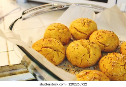 Sweet potato and pumpkin bread rolls freshly baked in a pyrex dish