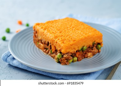 Sweet potato Shepherd's pie on a grey background. toning. selective focus