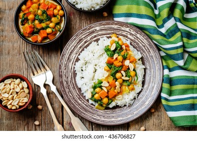 Sweet potato spinach chickpea curry with rice. toning. selective focus