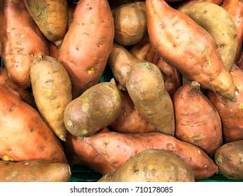 Sweet Potatoes; background of raw sweet potatoes