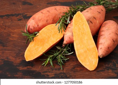 Sweet potatoes with branches of fresh rosemary