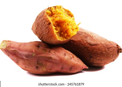 Sweet potatoes. Cooked whole and halved sweet potatoes.