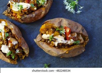 Sweet potatoes with spicy lentils, yellow pepper and tomato filling, thyme, garlic flowers and chipotle sour cream