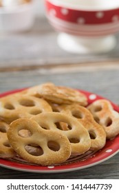 Sweet pretzels on a plate. Rustic style