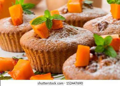 sweet pumpkin muffins with walnuts and powdered sugar