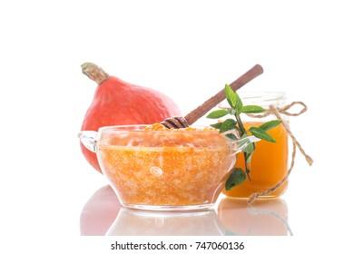 sweet pumpkin porridge with honey on a white background