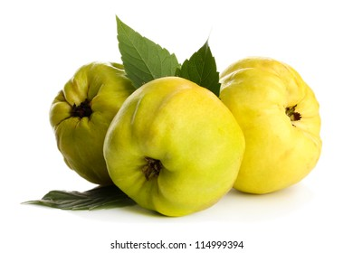 sweet quinces with leaves, isolated on white