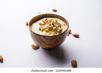 Sweet Rabdi or Lachha Rabri or basundi, made with pure milk garnished with dry fruits. Served in a bowl over moody background. Selective focus