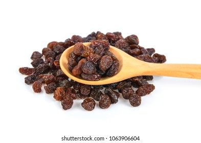 sweet raisin in wood spoon isolated on white background