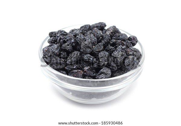 sweet raisins in a glass on a white background