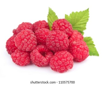 Sweet raspberries with leafs on white