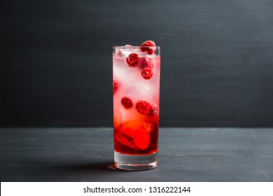 Sweet raspberry Tom collins cocktail. Selective focus. Shallow depth of field.