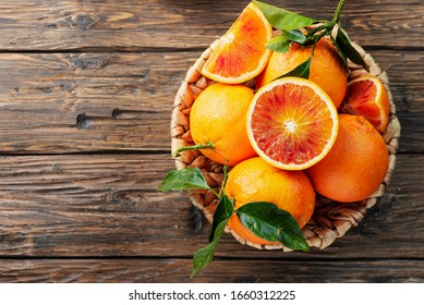 Sweet red oranges of Sicily in the basket, rustic style and selective focus