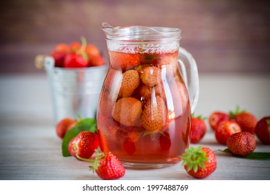 Sweet refreshing berry compote of ripe strawberries in a decanter