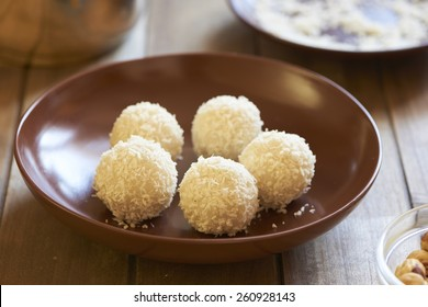 Sweet rice and coconut balls with hazelnut. Cooking process. Step 4. Rice balls are ready