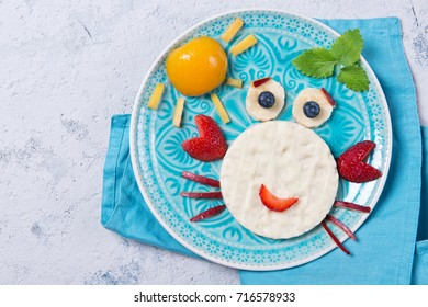 Sweet rice waffles with yogurt in the shape of a crab with fresh fruits, meal for kids idea, top view