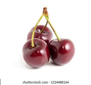 Sweet ripe cherry isolated on white background.