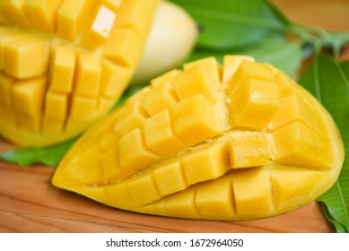 Sweet ripe mangos cut / Mango slice and mango leaves from tree tropical summer fruit concept