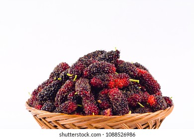 sweet ripe mulberry in  brown basket on white background healthy mulberry fruit food isolated