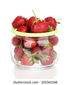 Sweet ripe strawberries in jar isolated on white