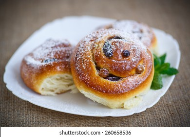 sweet rolls with raisins on the table