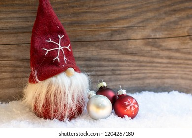 Sweet Santa Claus with glass balls in red and silver