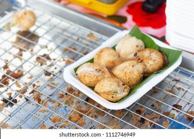 Sweet and Savory Grilled Coconut-Rice Hotcakes use name 'kanom krok' , sometimes use Coconut Rice Cake,Thai coconut pudding.