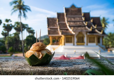 Sweet and Savory Grilled Coconut-Rice Hotcakes, Coconut Rice Cake on banana packaging, Asian dessert, Thai, Thailand, Luang Prabang, Laos. Wat Xieng Thong Golden City Temple