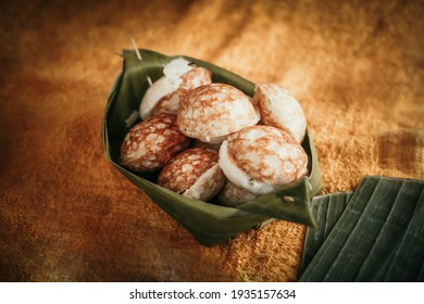 Sweet and Savory Grilled Coconut-Rice Hotcakes it's for kanom krok - Shutterstock ID 1935157634