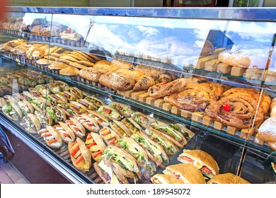 Sweet and savory take away street food display at Plaza de la Reina in Valencia, Spain