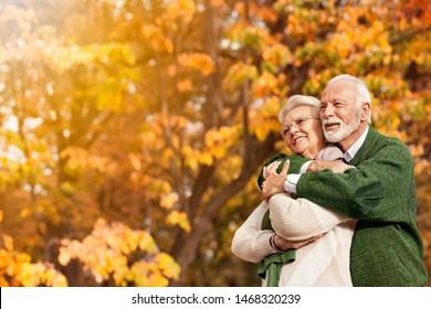 Sweet senior couple enjoy in autumn season. Taking in the beauty that surrounds them