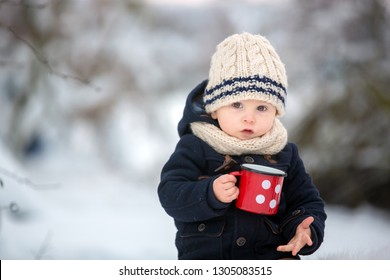 Sweet siblings, children having winter party in snowy forest. Kids friends rest outdoor at nature. Young brothers, boys, drinking tea from thermos. Hot drinks and beverage in cold weather
