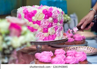 Sweet sixteen pink and white cake being cut before being served