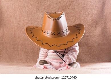 Sweet sleeping baby in a cowboy hat