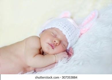 sweet sleeping newborn is wearing a bunny hat