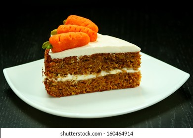 Sweet slice of carrot cake on white plate